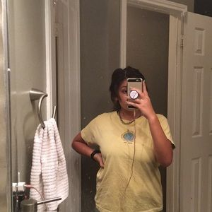 A darling pastel yellow Walk On shirt